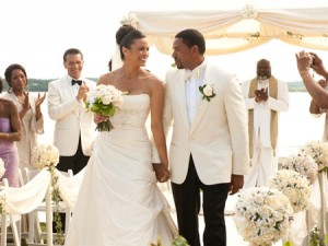 On-screen newlyweds Paula Patton and Laz Alonzo in the feel-good flick, Jumping the Broom.