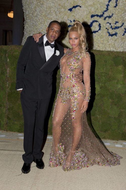 Jay Z in tk and Beyonce in Givenchy Haute Couture