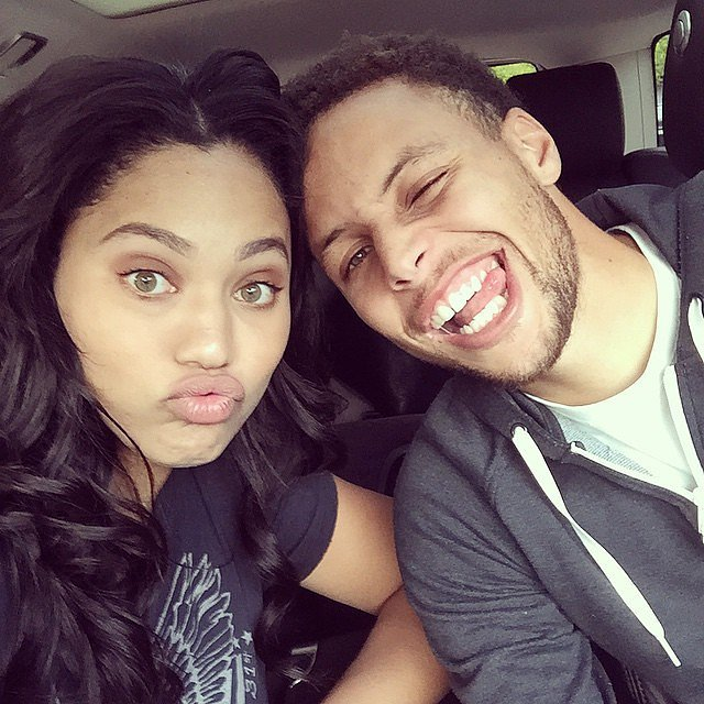 Love + Basketball: Ayesha and Stephen are camera ready with silly faces.